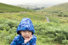 Child in green countryside Royalty Free Stock Photography