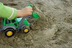 Child with green excavator Stock Images