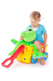 Child with a green frog Royalty Free Stock Photos