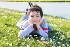 Child on the green grass. Happy child on the green grass Stock Image