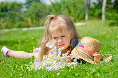 A child on a green lawn in the garden Royalty Free Stock Photography