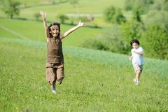 Child on green natural meadow. Kid on meadow green natural stock images
