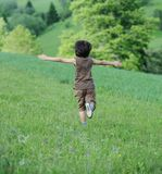 Child on green natural meadow Royalty Free Stock Image
