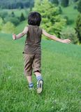 Child on green natural meadow Stock Photography