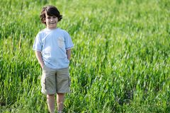 Child on green natural meadow Stock Photos