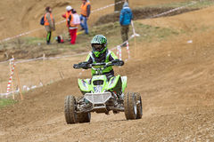 Child in green in quad race Royalty Free Stock Image
