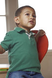 Child in a green shirt Stock Images