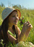 Child at green summer meadow Royalty Free Stock Photography