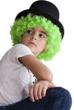 Child with green wig and hat. On white Royalty Free Stock Images