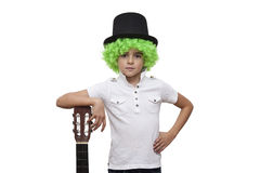 Child with green wig and hat on white Royalty Free Stock Photo