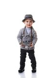 Child in grey hat holding retro photo camera Royalty Free Stock Photos