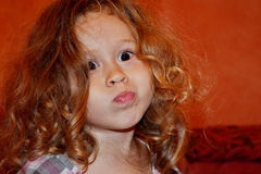 Child grimaces. Stock Photo