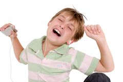 Child grooving to music. A child enjoying music on an mp3 player Stock Photography