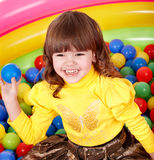 Child in group colourful ball. Royalty Free Stock Photography