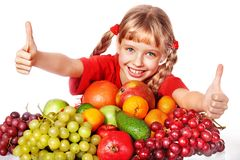 Child with group fruit and vegetable. Royalty Free Stock Photo