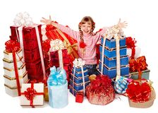 Child with group gift box thumb up. Royalty Free Stock Photo