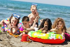 Child group have fun and play with beach toys Stock Image