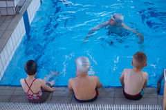 Child group  at swimming pool school class Royalty Free Stock Image