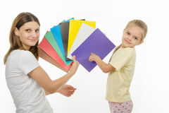 Child guesses color in image the hands of women Royalty Free Stock Image