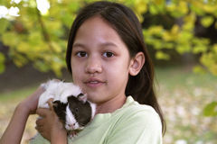 Child with guinea pigs Stock Photography