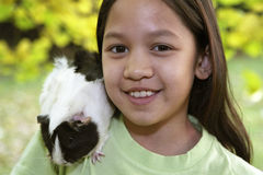 Child with guinea pigs Royalty Free Stock Image