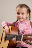 Child with guitar stock image