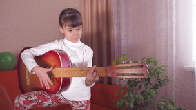 Child with guitar. stock footage
