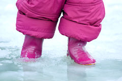 Child  gumboots in a puddle Royalty Free Stock Image