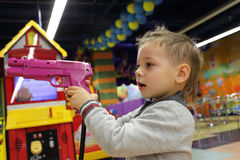 Child with gun Royalty Free Stock Image