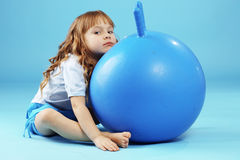 Child with gymnastic ball Royalty Free Stock Photo