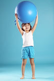 Child with gymnastic ball Stock Photos