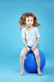 Child with gymnastic ball Royalty Free Stock Images