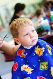 Child at the hairdresser stock images