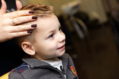 Child at hairdresser salon Stock Image