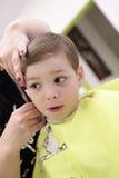 Child at hairdresser salon Stock Images