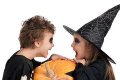 Child in halloween costume. Boy and girl wearing halloween costume with pumpkin on white background Stock Photography