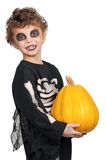 Child in halloween costume. Portrait of little boy wearing halloween costume with pumpkin on white background Stock Image