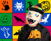 Child with halloween mask and pumpkin Stock Images
