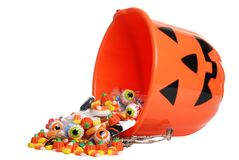 Child Halloween Pumpkin Bucket Spilling Candy Royalty Free Stock Image