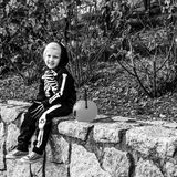 Child with Halloween pumpkin Jack O'Lantern basket on parapet Stock Photography