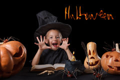 Child, Halloween pumpkin, magical things  on black Stock Image