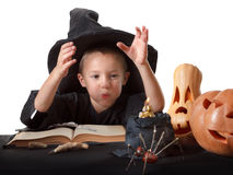 Child, Halloween pumpkin with magical things Royalty Free Stock Photos