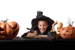 Child, Halloween pumpkins and magical things Stock Image