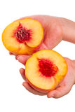 Child with Halves of  peach on white Stock Images