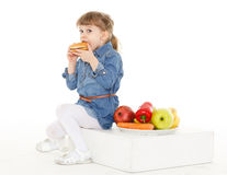 Child with hamburger and fruits. Stock Photography