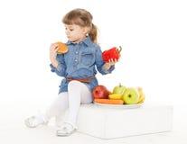 Child with hamburger and fruits. Stock Photo