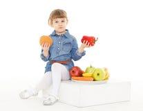 Child with hamburger and fruits. Stock Image