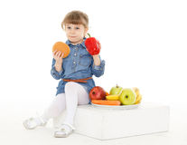 Child with hamburger and fruits. Stock Images