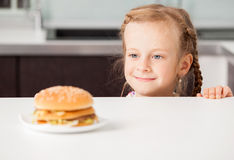Child with hamburger Stock Photography