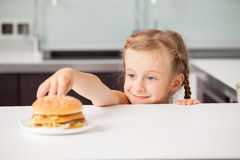Child with hamburger Royalty Free Stock Photography